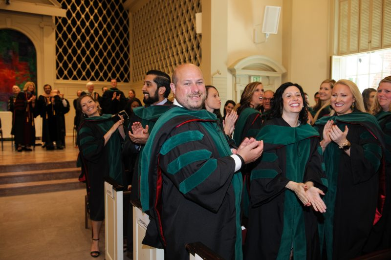 Graduates clap hands in Snidow Chapel