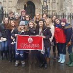 Students holding a University of Lynchburg banner in England.
