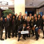 """Model UN team with one student holding a sign reading """"Luxembourg"""""""
