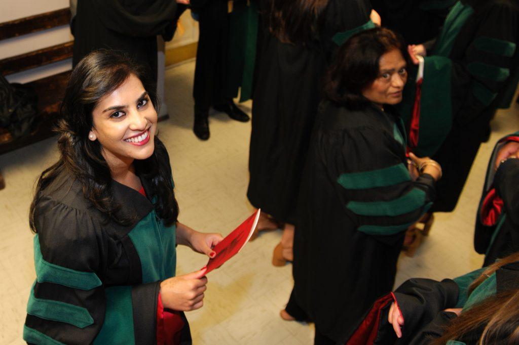 Graduates walking in to Snidow Chapel