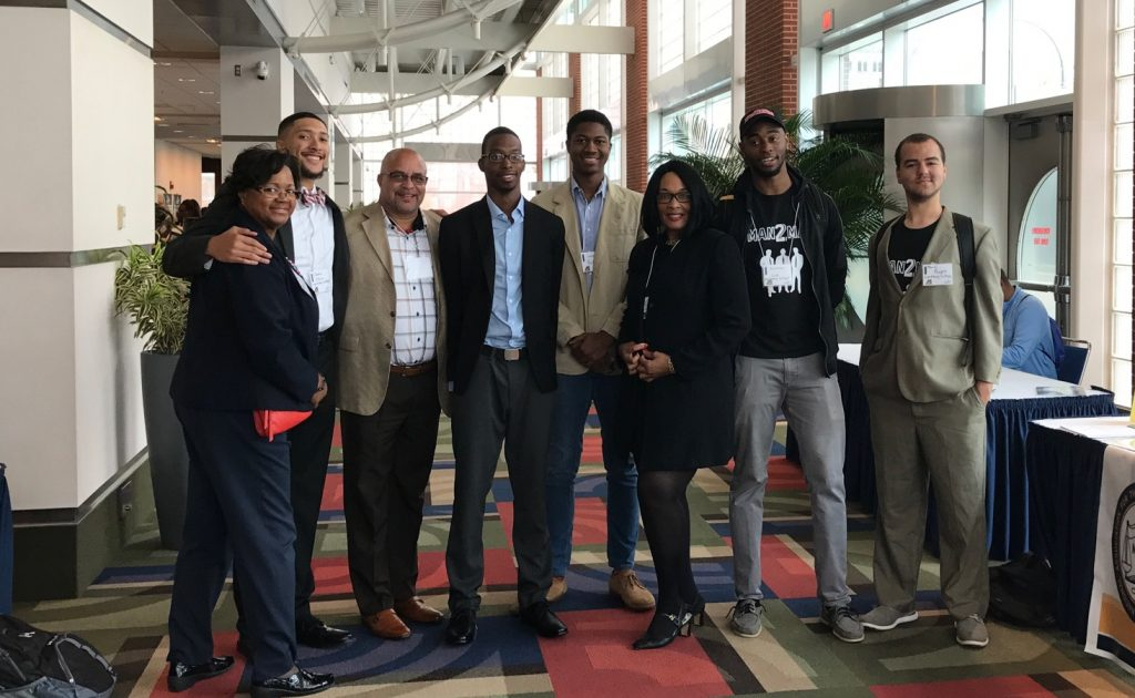 Members of the Man 2 Man student group with people they met at the Black Male Summit.