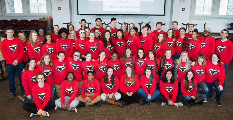 About 50 students wearing Emergin Leader Retreat t shirts