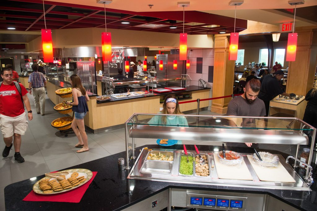 Students get food at a serving station in the newly renovated dining hall serving area.