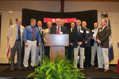 Members of the 1991 men's cross country team receive their recognition.