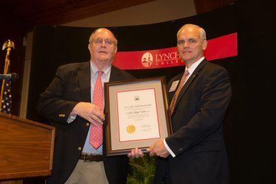 Skipper Holt receives his T. Gibson Hobbs Memorial Award.