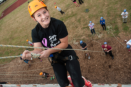 Student climbing on the climbing wall