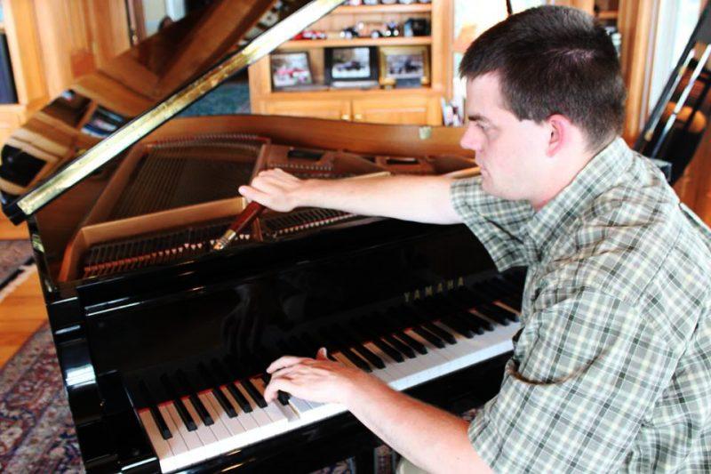 John Pastorius tuning a piano.