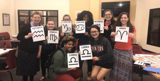 Latin club holding signs with abbreviations for zodiac signs