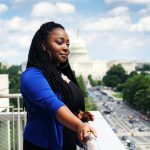 D'Andria Alston-Thomas overlooks Washington D.C. Capitol Building is seen in the background